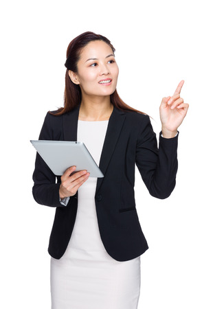 Business woman hold tablet with finger up photo