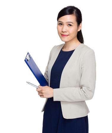 Asian secretary with file pad photo