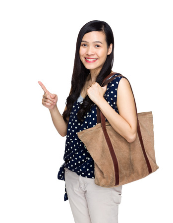tote: Asian woman with tote bag and finger point out