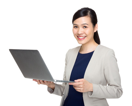 Asian business woman with laptop computer photo