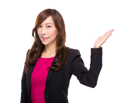 Business woman with hand presentation photo
