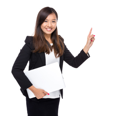 Asian business woman with laptop computer and finger point out Stock Photo
