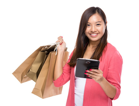 Asian woman with tablet and shopping bag photo