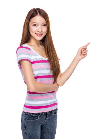 Young woman finger point out Reklamní fotografie