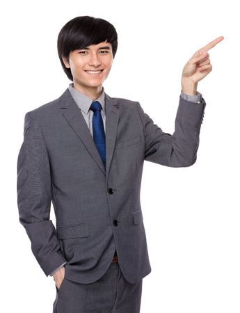 Businessman finger point up photo
