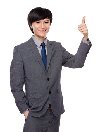 Businessman thumb up photo