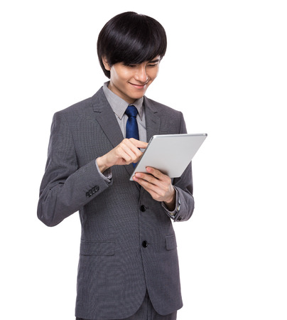 Businessman look at digital tablet photo