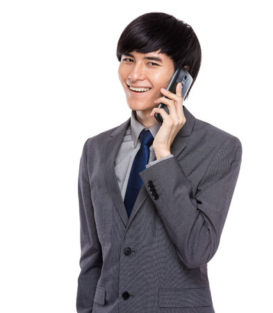 Businessman talk to mobile phone photo