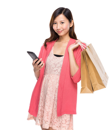 Woman hold with shopping bag and mobile phone photo