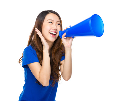 Excited young woman shout with loudspeaker photo