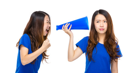 annoy: Woman yell to other with megaphone