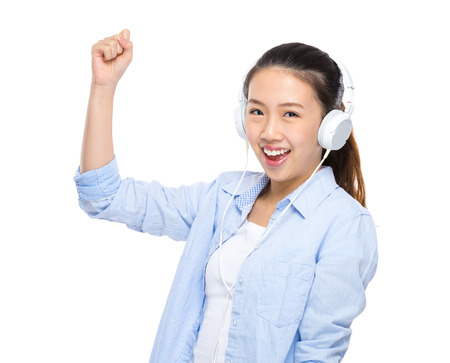 Happy young woman listen to music by headphone