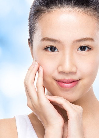 Skin care woman with blue background photo