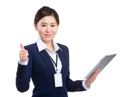 buisness woman: Asian buisness woman hold digital tablet and thumb up Stock Photo