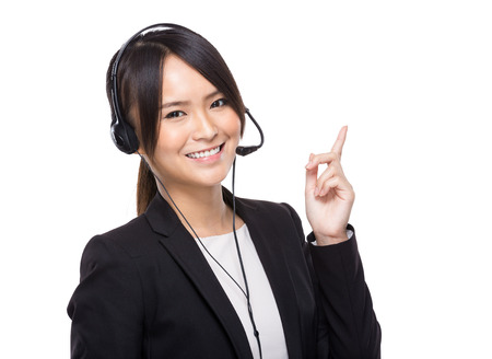 Businesswoman with headset with finger up photo