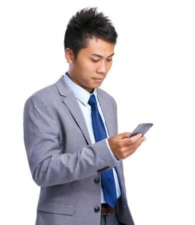 Businessman use mobile phone photo
