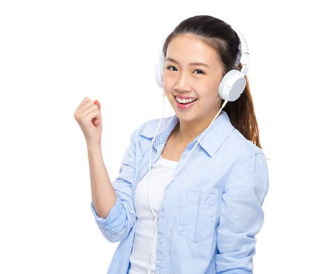 listen fist: Young woman listen to music by headphone