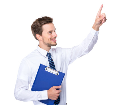 Caucasian businessman hold clipboard look at the finger point up photo