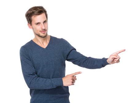 aside: Caucasian man with two finger point aside Stock Photo