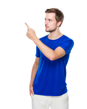 aside: Young man look at finger point to aside Stock Photo