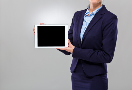 Businesswoman show the blank screen of digital tablet photo