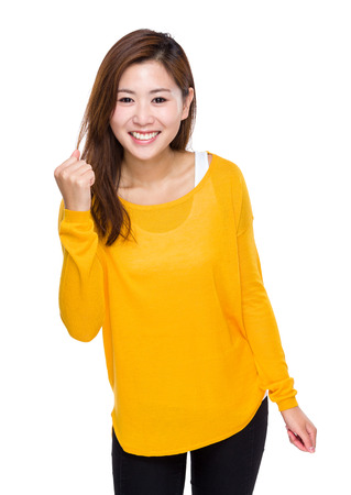 clench: Cheerful asian woman hold clench
