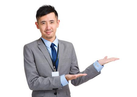 Asian businessman with hand presentation photo