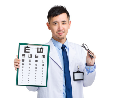oculist: Oculist hold with eye chart and glasses Stock Photo