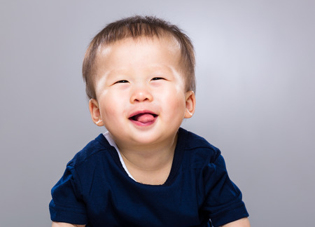 Little boy with tongue sticking out photo