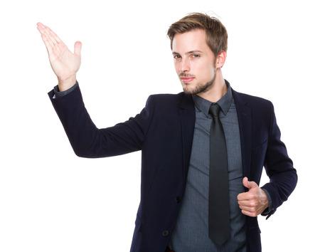 Caucasian businessman with hand presentation photo