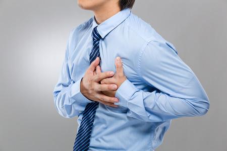 ataque cardiaco: Hombre de negocios que sufren de un ataque al corazón