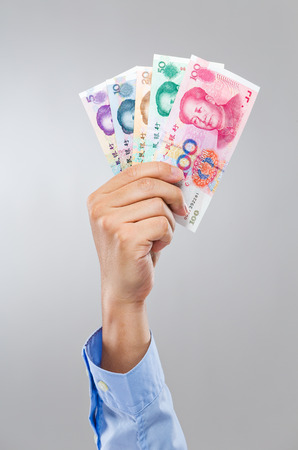 Businessman hand hold different chinese banknote photo