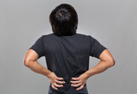 boy muscles: Man with back pain