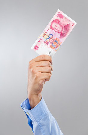 Businessman hand hold hundred chinese renminbi photo