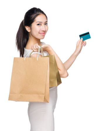 hold: Woman with shopping bag and credit card