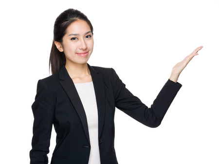 Asian businesswoman with open palm photo