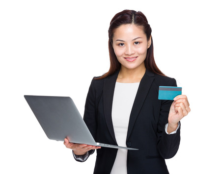Woman with laptop credit card photo