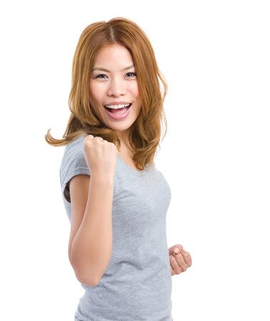clenching: Woman clenching fist Stock Photo