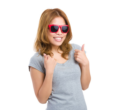 Woman thumb up with sunglasses photo
