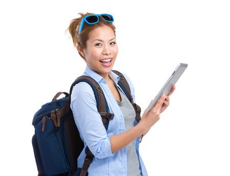Woman traveler use tablet photo