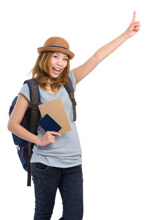 lets: Young woman with backpack finger pointing up Stock Photo
