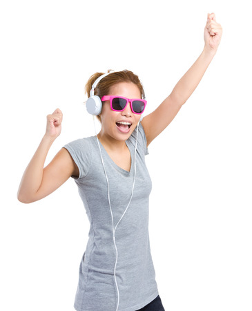 Excited woman with headphone photo