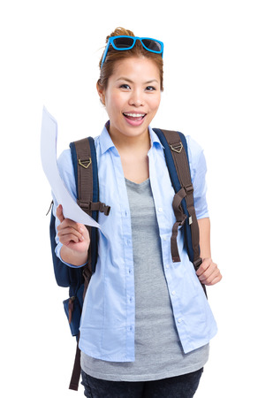 Asian woman with backpack and travel information photo