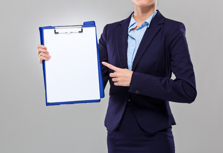 Businesswoman show with white paper of clipboard photo