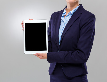 Businesswoman show with blank screen of tablet photo