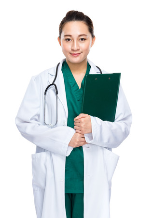 Indonesian female doctor with clipboard photo