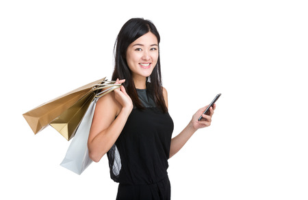Asian young woman hold mobile phone with shopping bag photo