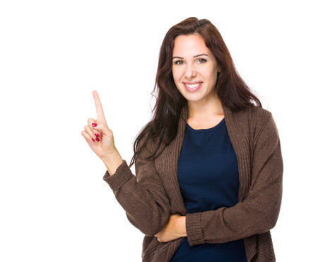 Brunette woman with finger up