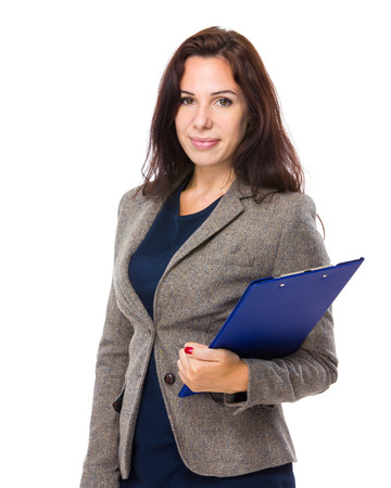 Brunette woman with clipboard photo