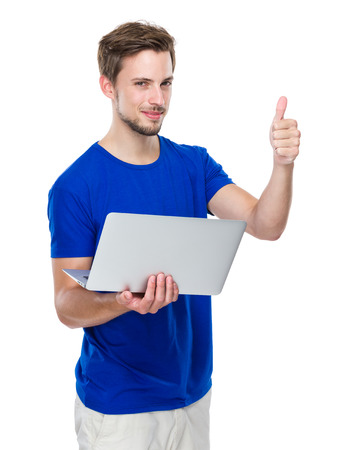Man use of laptop computer and thumb up photo